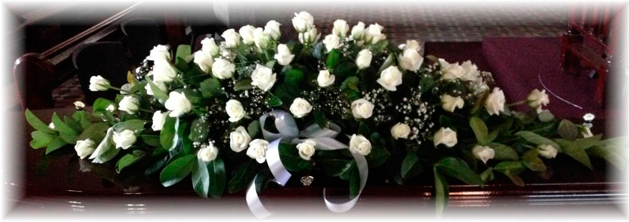 double ended white rose casket spray - lincoln family funerals