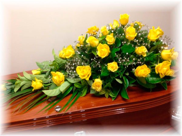 yellow roses funeral floral arrangement - lincoln family funerals